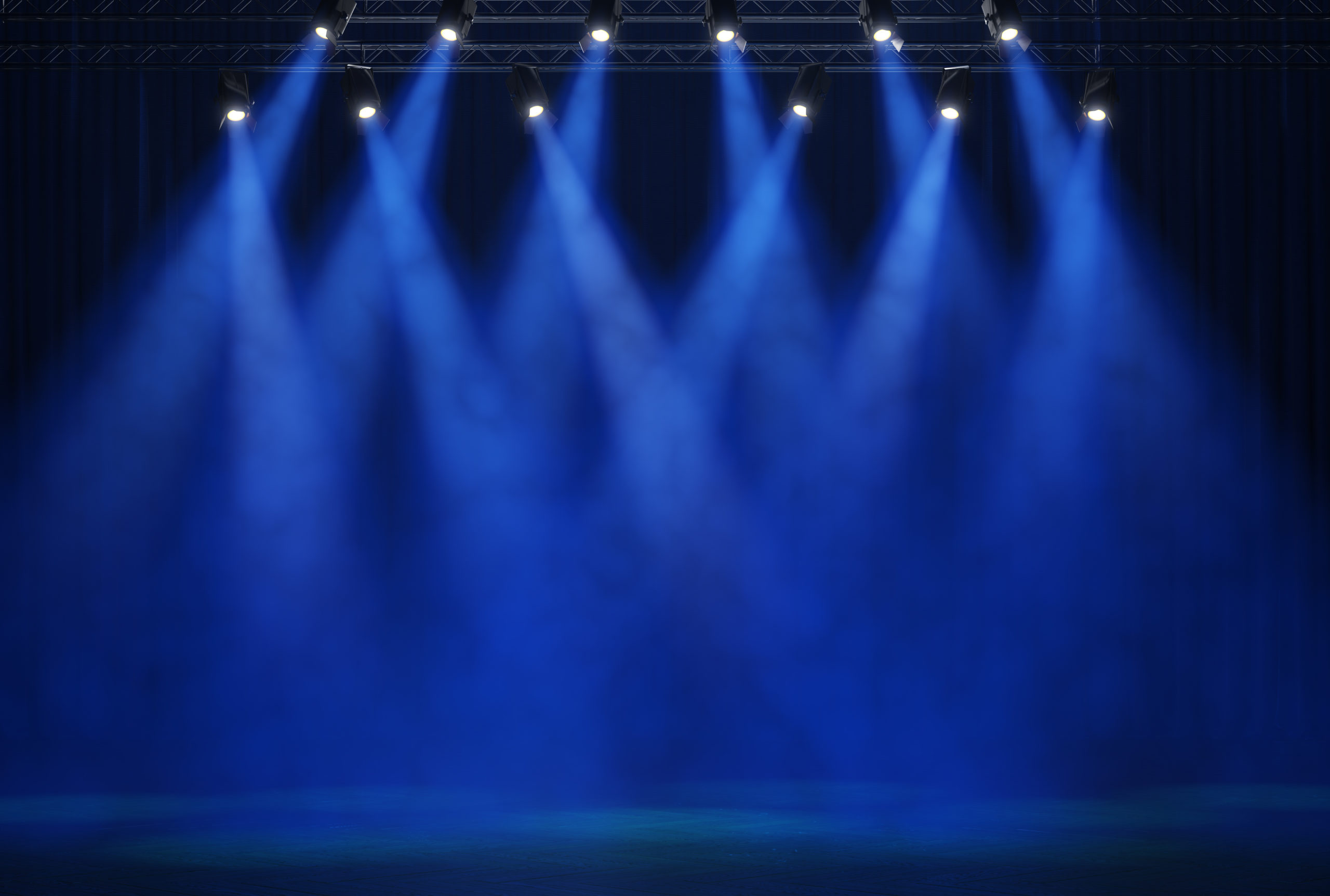 A empty stage lit with blue light